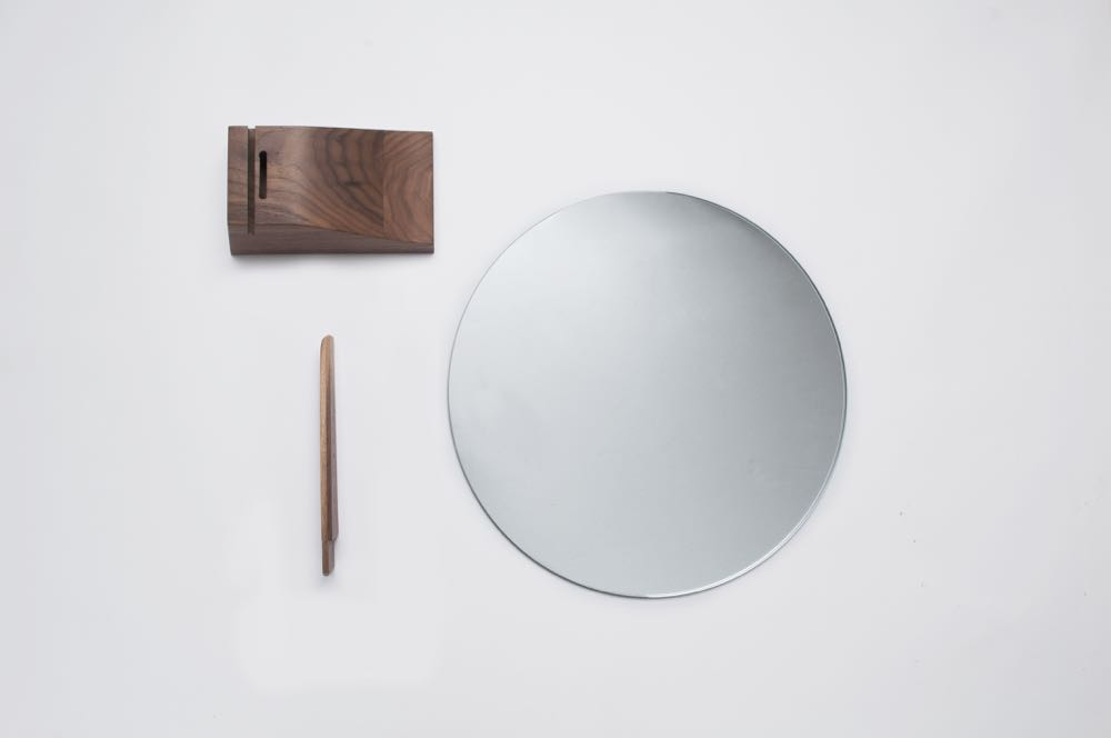 The exploded view of Jacques Emile Ruhlmann's 'Lalou'. A simple disc-shaped mirror with wooden support.