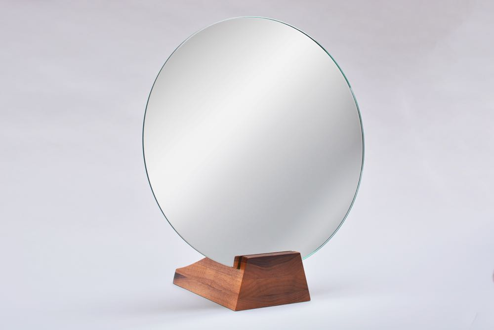 Originally designed in 1928 the 'Lalou' mirror comes in walnut or black stained oak.