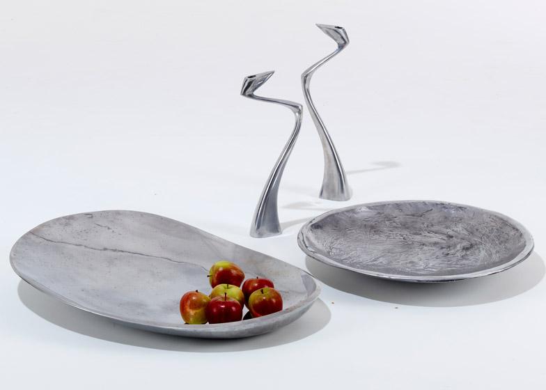 British designer Matthew Hilton's Swan candlesticksand 'Metalware' bowls from 1987. Reissued by SCP.