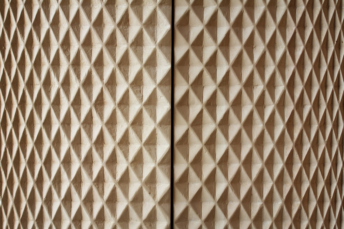 A close up of the surface of the 'Mr Quin' cabinet revealing its folded diamond pattern.