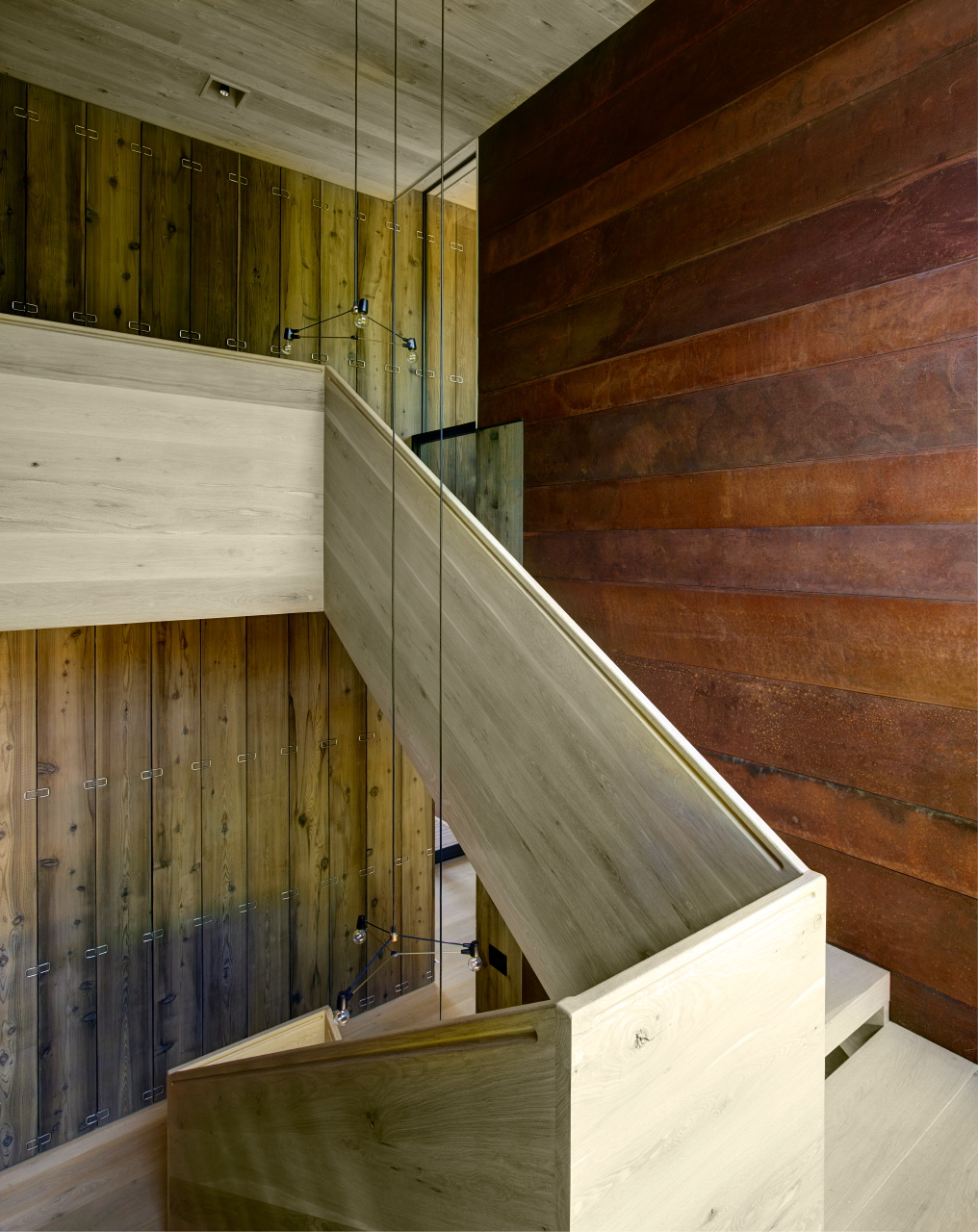 The double height stairwell of the 'Masi House' dramatically combines cedar, concrete and copper.