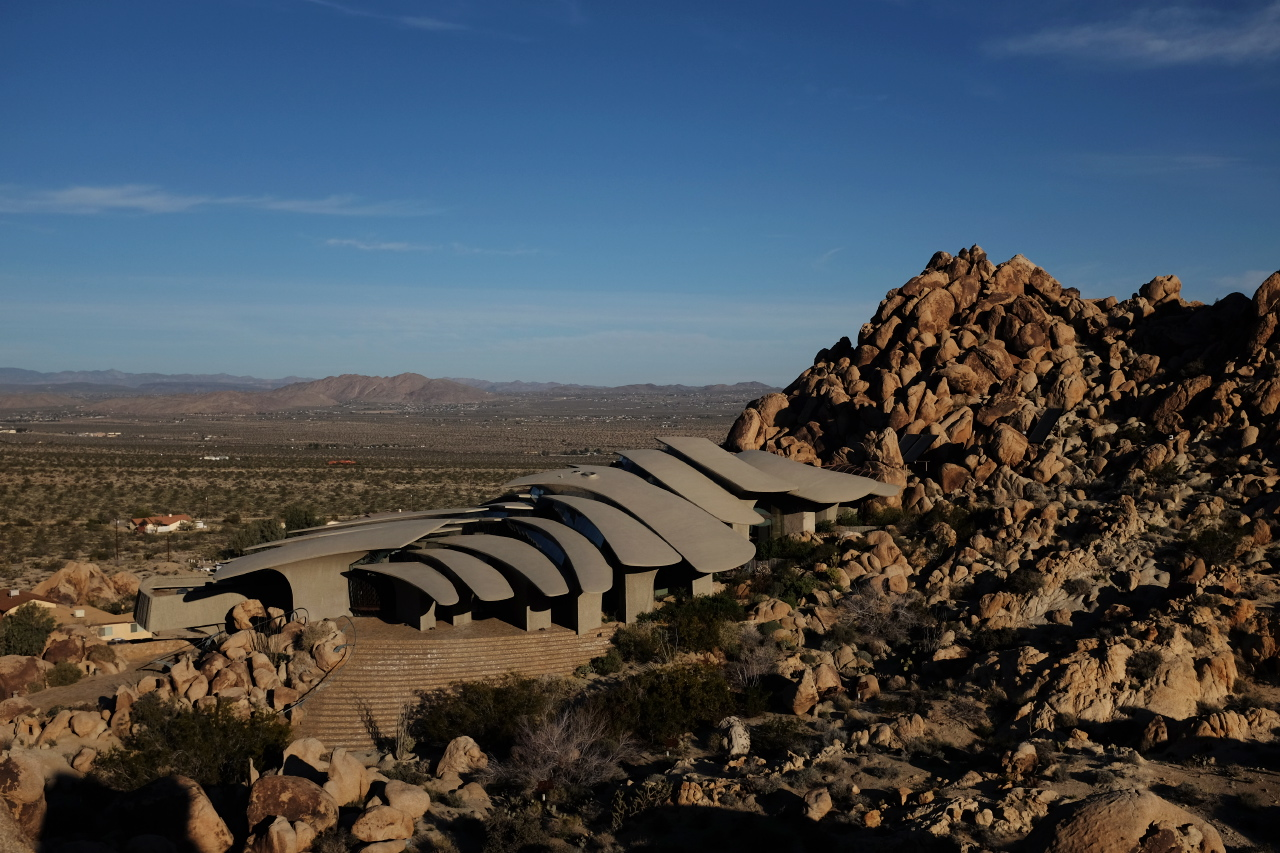 The 'High Desert House' by architects, Kendrick Bangs Kellogg, slides down the rocky terrain near Joshua Tree and meets the flat plain beyond.