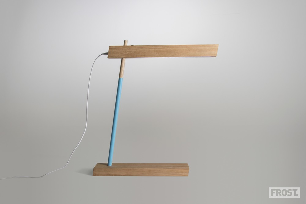 Outwardly simple, the 'Italic' desk lamp by Jack Frost houses an LED light source and a USB charging port.