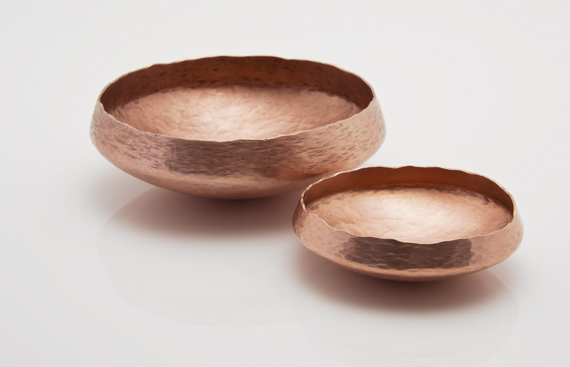 Hand raised bowls in copper by Alison Jackson.