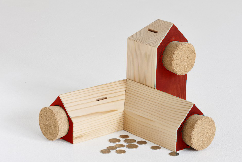 The 'Equity' money boxes by Elliot Gorham for Noddy Boffin are interlocking house modules in pine with painted accents and a cork stopper.