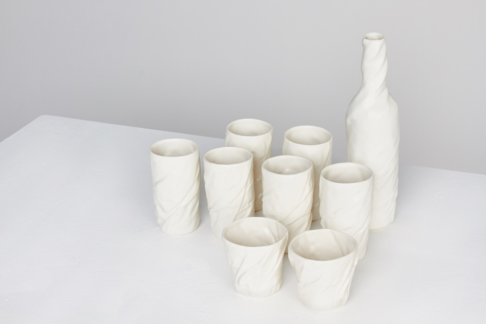 'Wrapping' - a set of bottle and beaker forms, designed by  Little Wonder  (Gyungju Chyon & John Sadar).Glazed slip cast porcelain from 3-D scans of crumpled paper.Designed in2008. One-off set.
