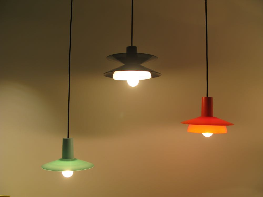 Jon Goulder's 'Flip' lights in painted timber and glass, come in three shapes and a range of colours.