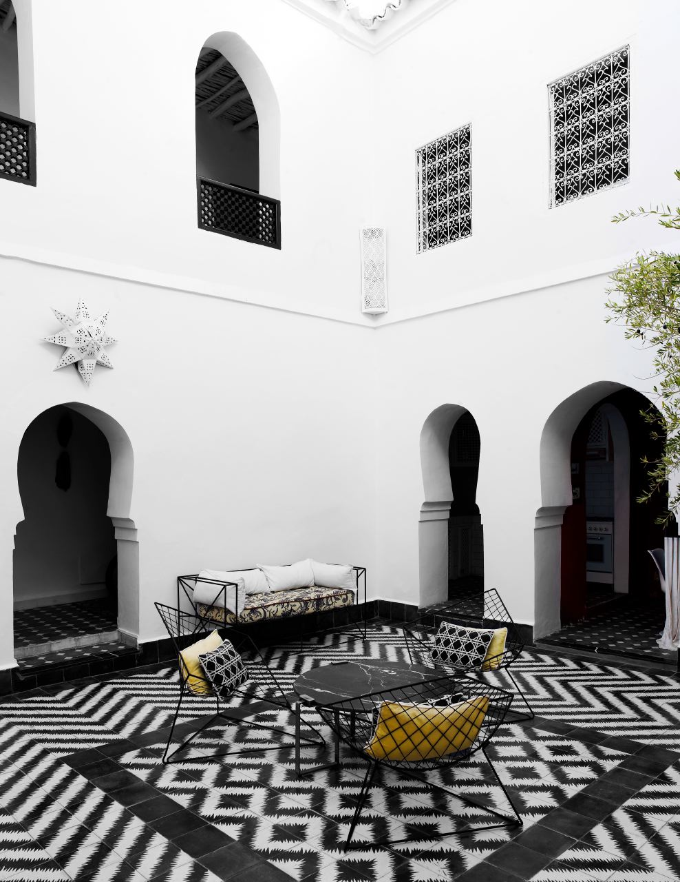 The exotically tiled courtyard of Samuel & Caitlin Dowe-Sands' 18th century house in Marrakesh. The Dowe-Sands run hand made Moroccan tile company,  Popham Design .