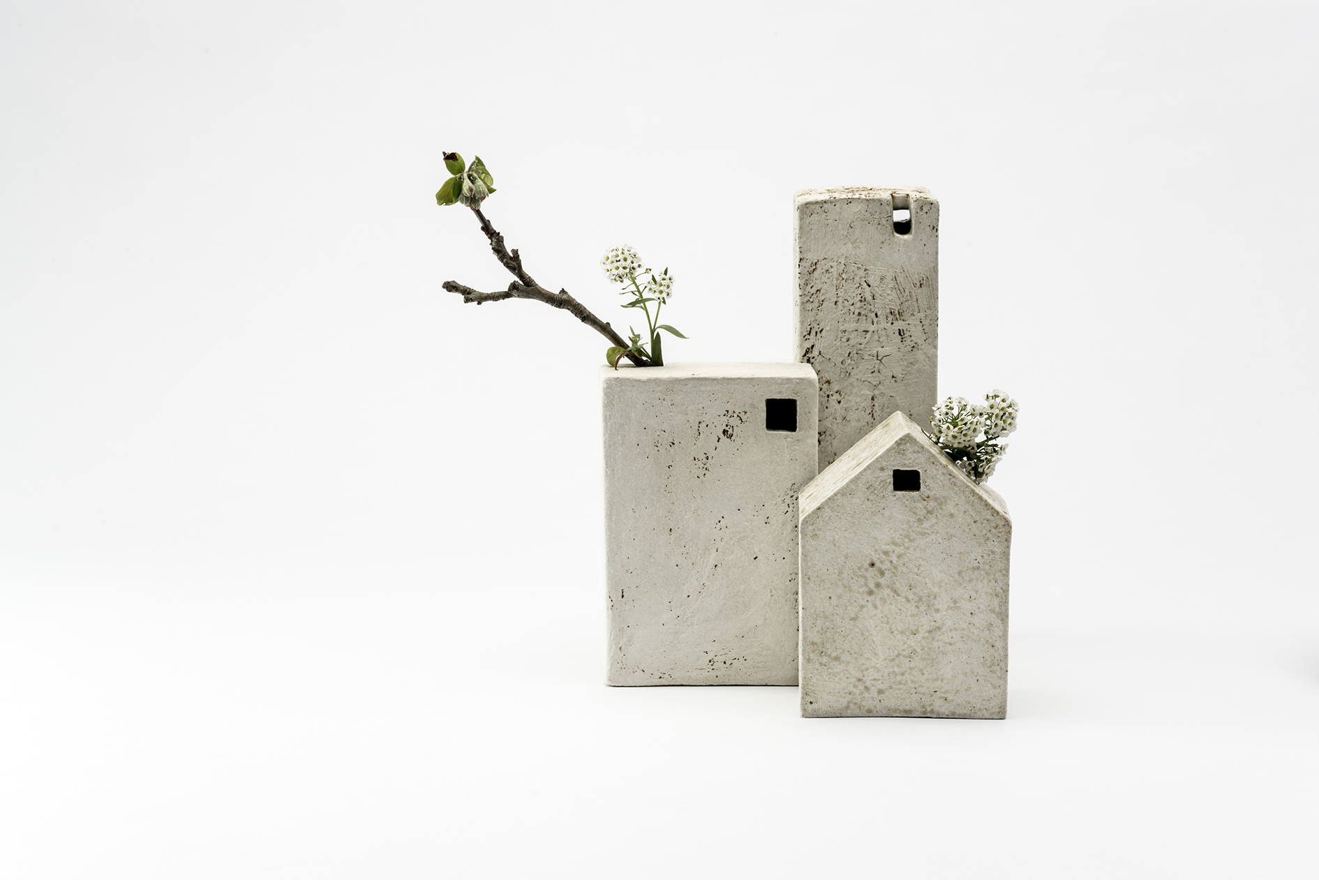 'House Vase' objects with blossom. Window-like incisions add practicality. Photo Greg Piper