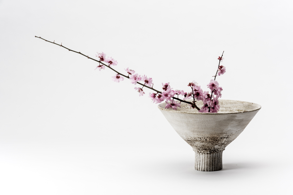 A stoneware bowl with incised foot and plum blossom. Photo by Greg Piper.