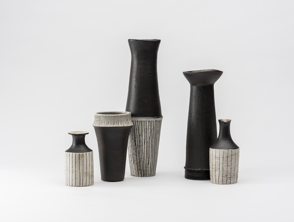 Her stoneware vase and bottles forms reveal another side of Keiko's work with influences from great British potters Lucie Rie and Hans Coper. Photo by Greg Piper.