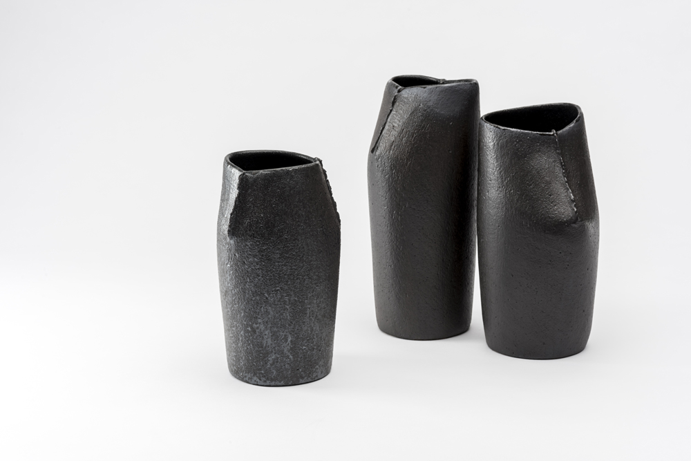 The black 'Scar' vessels have a very different aesthetic to the usual white porcelain versions.They become totemic artefacts, almost like Easter Island statues.Photo by Greg Piper.