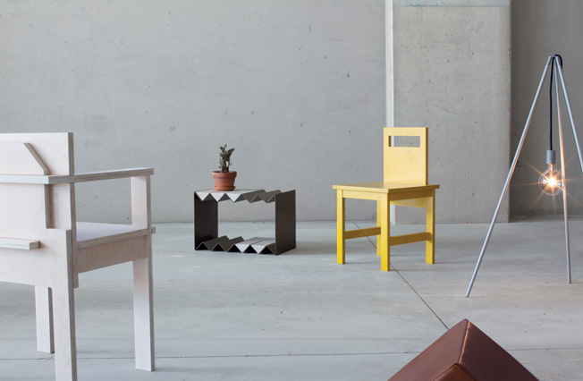 Objects from the  Optical Delusions  collection: 'Slab' chair, 'Zig Zag' table (and far right) the 'Tipi' light.
