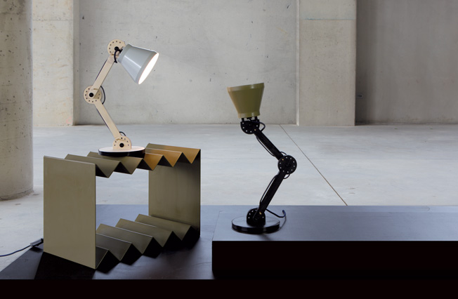 The 'Protractor' lamp from the  Optical Delusions  collection combines a shade in spun metal with timber arms. The position is adjusted via a locating pin - a satisfyingly manual method.