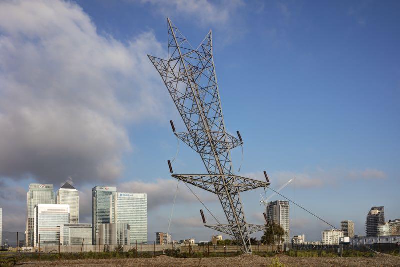 Alex Chinneck's 'Pylon' a 35 metre high sculpture erected on waste ground in Greenwich.