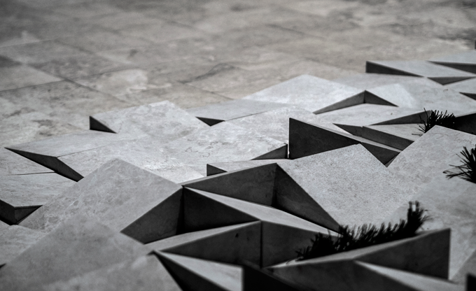 Gum Design's 'Botticino' installation at the Fiera Verona 2015 showed a transition of marble from smooth honed tiles to split three dimension blocks with spaces for small plants.