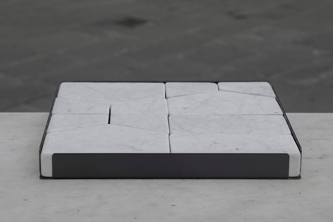 'Paesaggi Variabili' by Gum Design for Friul Mosaic and De Castelli 2014. A flat tray of marble blocks in iconic house shapes. Photo Alessandro Culos.