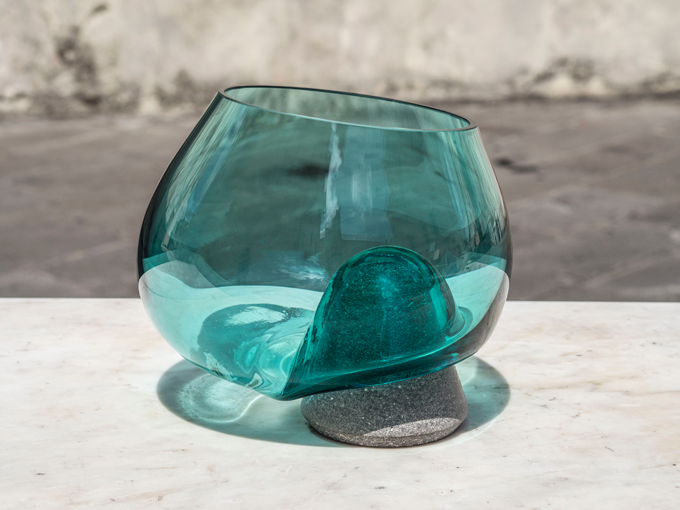 'Cumuli' by Gum Design for Studio Formart and IVV952. The vessels are inspired by Sicilian salt piles and are made from Basalt stone and mouth blown glass. Photo Laura Fiaschi.