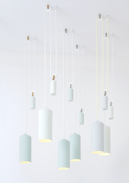 Studio WM's 'Porcelain light' with its perfectly weighted counterweight in solid porcelain suspended from a pulley. The colours of this lamp are beautifully soft sorbet tones. Photo: Paul Schipper.