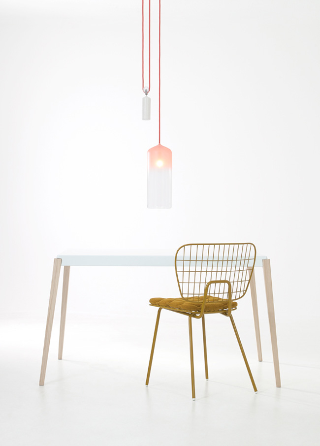 The 'Dining' Now 'WM String' chair in its original ochre colour with the 'Gradient' lamp and 'Aphis' table - all part of the  Lightness in Lines  collection presented at Dutch Design Week October 2011.