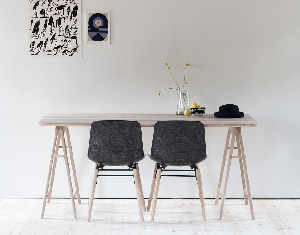 The 'Hembury' chair by Solidwool has a unique look due to the natural variation in the colour of the Hardwick fleece used to strengthen the resin. Shown here with the 'Samara' table by  Feist Forest