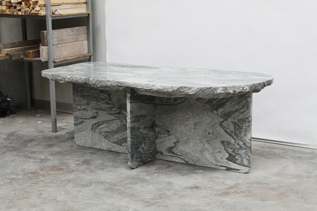 'Fragments' dining table in green granite. The solid stone table is two metres long and ninety centimetres wide.