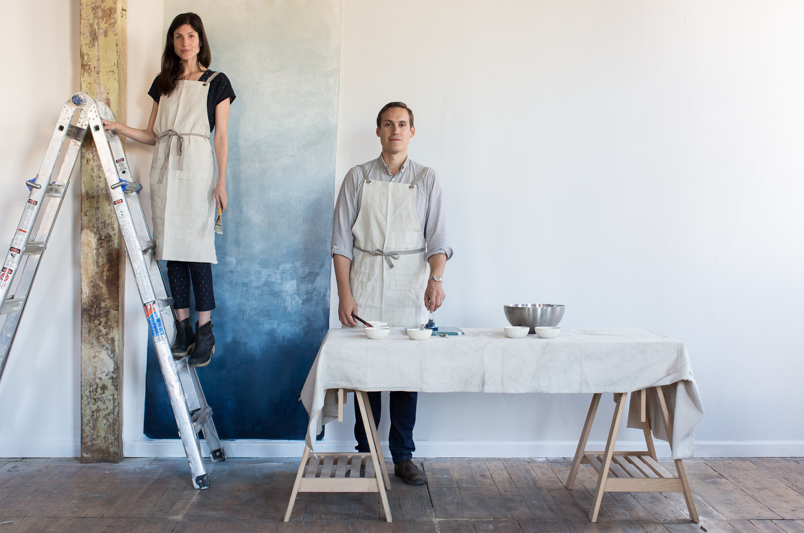 A little teaser of what the  Fragments wallcovering will possibly look like - graduating through dark grey to natural linen from the floor to the ceiling. Rachell and Nicholas try on their linen aprons for the camera.