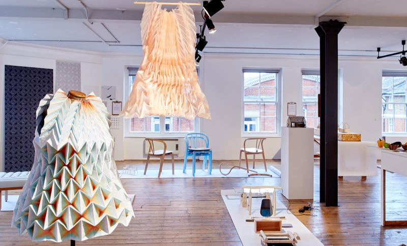 The folded paper dresses of Jule Waibel with Tomoko Azumi's 'Flow 'chairs for Ercol in the background.