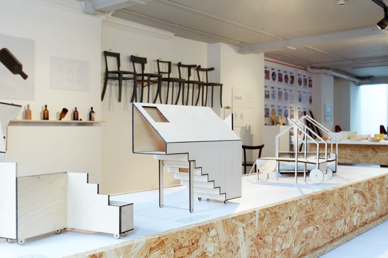"""Carl Turner Architects Home from Home maquettes in plywood showing their interlocking nature. In the background are Felix de Pass' bottles and 'Chair 182' prototypes by         96               Normal   0           false   false   false     EN-US   X-NONE   X-NONE                                                                                                                                                                                                                                                                                                                                                                                                                                                                                                                                                                                                                                                                                                                                                                                                                                                                                  /* Style Definitions */ table.MsoNormalTable {mso-style-name:""""Table Normal""""; mso-tstyle-rowband-size:0; mso-tstyle-colband-size:0; mso-style-noshow:yes; mso-style-priority:99; mso-style-parent:""""""""; mso-padding-alt:0cm 5.4pt 0cm 5.4pt; mso-para-margin:0cm; mso-para-margin-bottom:.0001pt; mso-pagination:widow-orphan; font-size:12.0pt; font-family:Calibri; mso-ascii-font-family:Calibri; mso-ascii-theme-font:minor-latin; mso-hansi-font-family:Calibri; mso-hansi-theme-font:minor-latin;}      Carmody Groarke with Joe Pipal."""