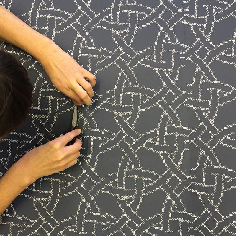 Custom's 'New Cross' wallpaper being trimmed.