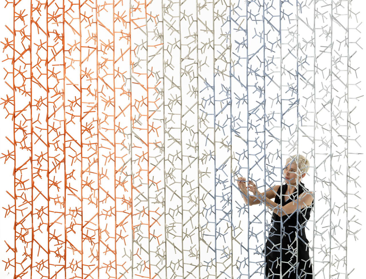The 'Amass' screen was developed as an installation work for London Design Festival in 2013. The screen resembles random twigs but is a high-tech and highly complex solution.
