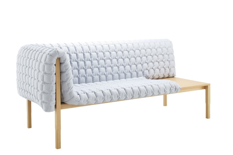 The 'Ruche' sofa for Ligne Roset (2010). The heavy quilted upholstery appears to be simply draped on the timber frame for the ultimate in tactile but minimal seating.