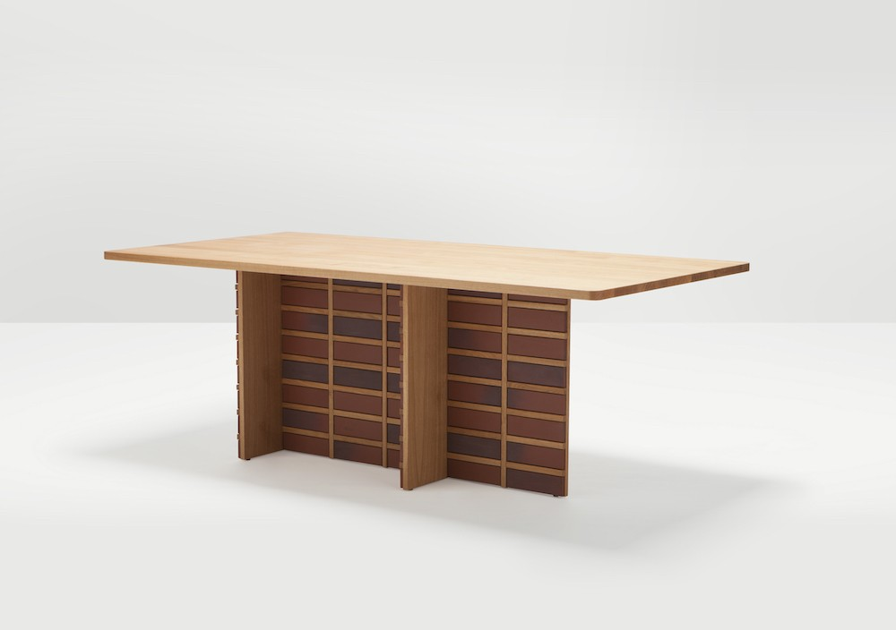One example of a table from the Brick collection. The veneer of brick is only on one side for an added surprise. The tonal variation found in bricks brings increased complexity to the design.