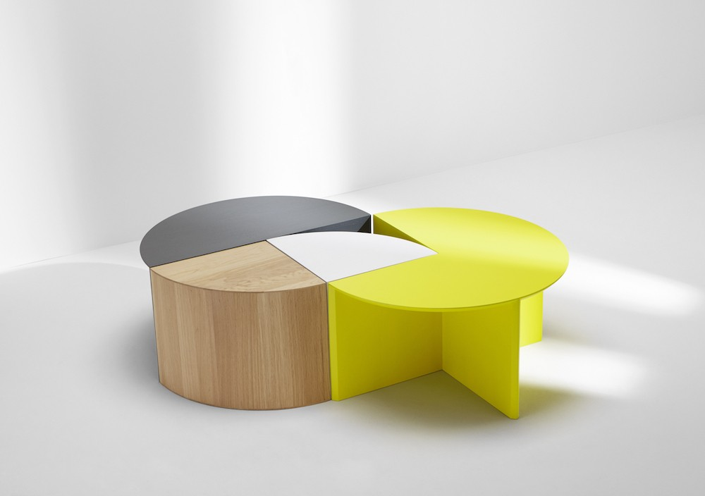 The 'Pie chart' system of side tables. The range is based on the four quadrants of a circle. There are one quarter, half, three quarter and full circle tables which can combine to form interesting compositions.
