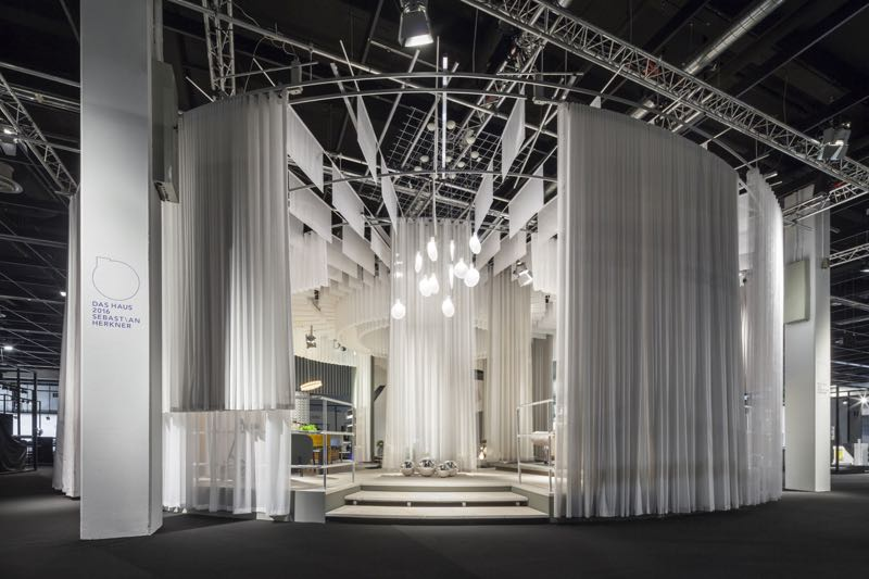 Sebastian Herkner's design for IMM Cologne's annual feature exhibit Das Haus. The circular display consisted of acres of white fabric and no less than 19 new Herkner products.