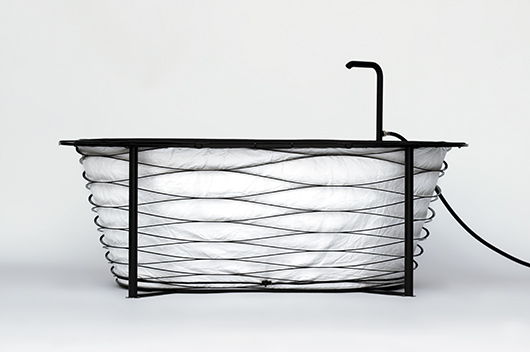 One of the entrants in the Pure Talents Contest, 'XTEND' by Carina Deuschl is a flat pack bath that combines a waterproof fabric supported by a concertina of carbon fibre strips and four metal legs.