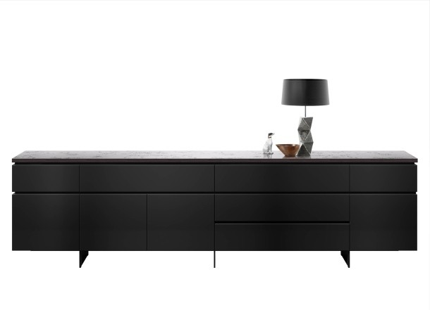 Werner Aisslinger's 'Cube Gap' sideboard was shown with a new top finish called Black Concrete. It's actually a mixture of limestone and marble granules with acrylic resin. It not only looks nice but adds a degree of texture that works beautifully with the sleekness of the cabinet itself.