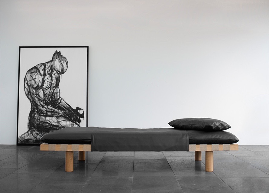 Herkner's 'Pallet' daybed for Pulpo. The black leather 'cape' has a little of the masked avenger about it - also shown in the artwork used in the image.