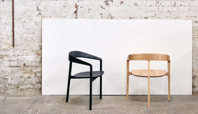 The 'Bow' chair in black stained and natural ash versions. The striking grain found in ash is a strong feature.
