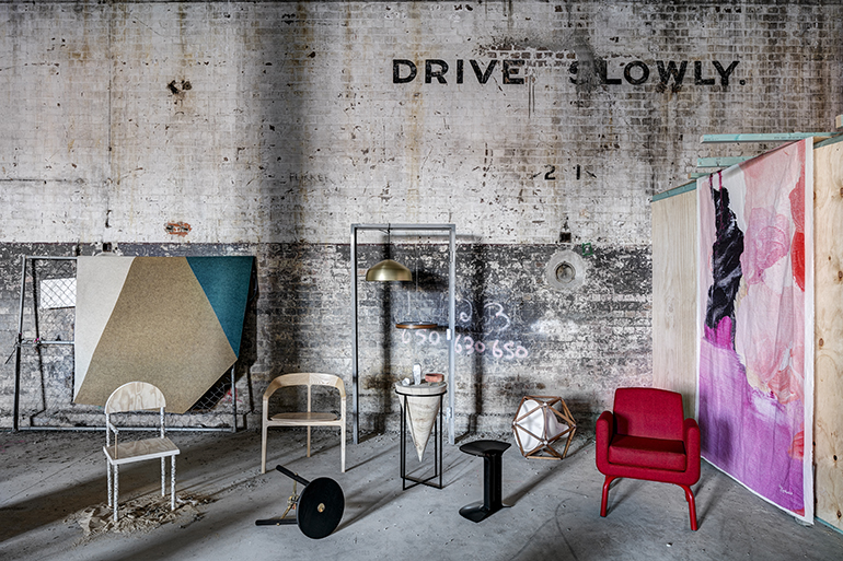 A promotional image for Local Design's LD1 exhibition featuring Feredays 'Bow' chair along with pieces by Australian designers, DAAST, Ross Gardam, Toby Jones, Fiona Lynch, Henry Pilcher, Rachel Vosila and more