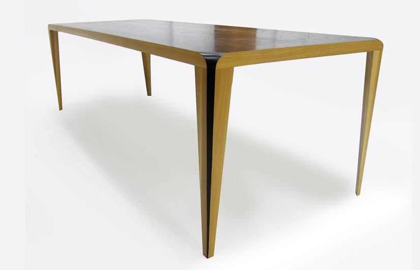 The 'Dye' table for CDR (Craft Design Realisation) 2011. Solid oak with a lacquered black top that 'pours' over the table top and down the edge of the four legs. A simple but highly dramatic detail.