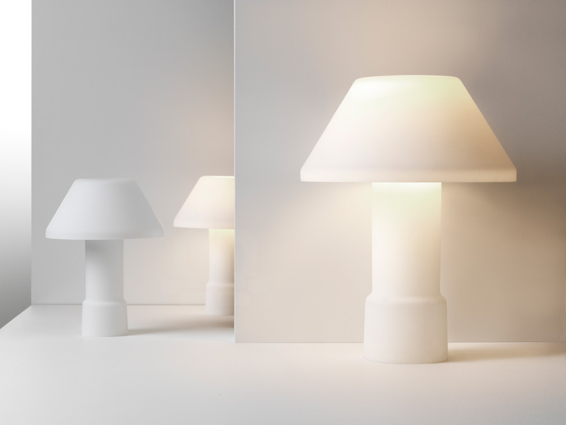 Inga Sempe's w163 'Lampyre' table lamp for Wästberg. With just two opaline glass pieces the light is dimmed from a extremely bright to a minimal halo effect.