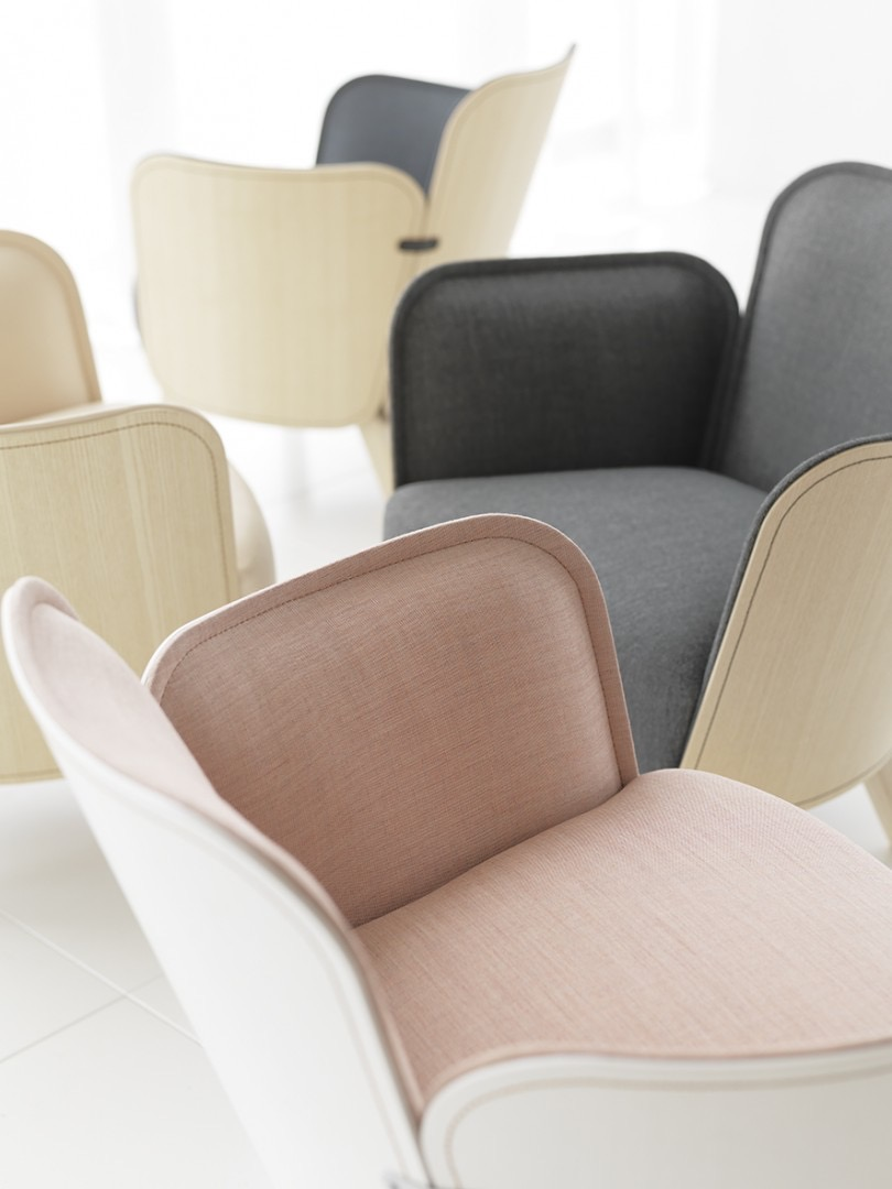 A close-up of several 'Julius' chairs by Färg & Blanche for Gärsnäs.