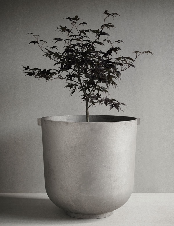 The 'Castle' planter by Friends & Founders. Made from recycled aluminium it is available raw or in black.