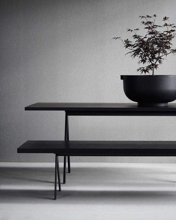 The well received 'Saw' table and bench from the brand's last collection now also comes with marble tops. The pot on the table is a smaller, lower version of the 'Castle' planter shown earlier.