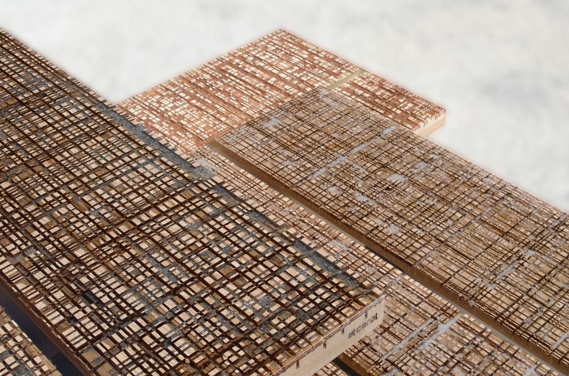 A close up of Alcoral's 'Marbleways' showing the heavily used marble cutting boards coated in resin.