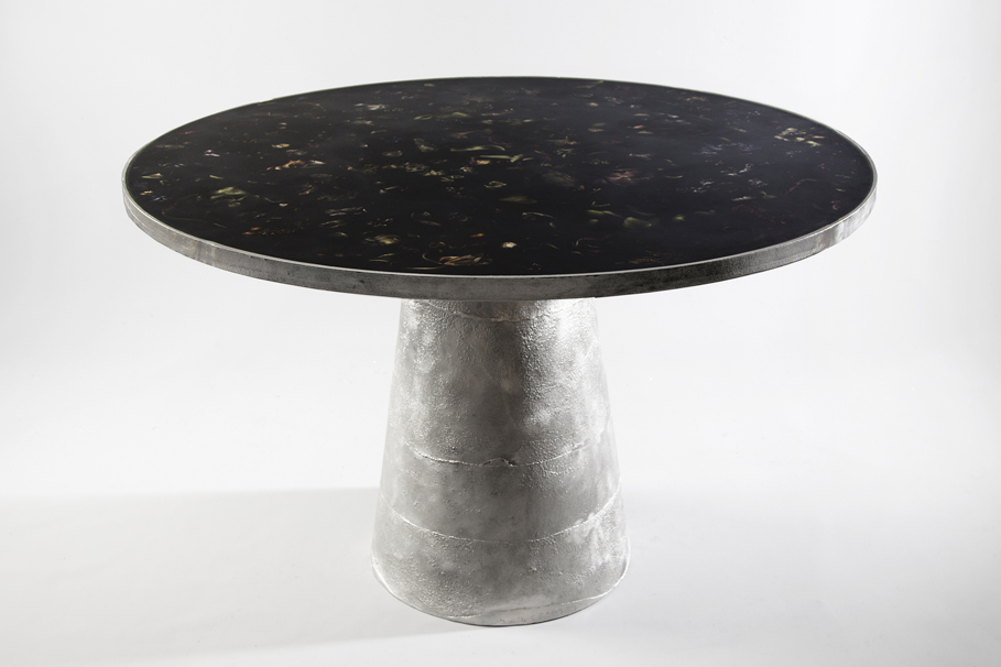 'Flora' table by Marcin Rusak - a cast aluminium base with resin top embedded with real flowers.