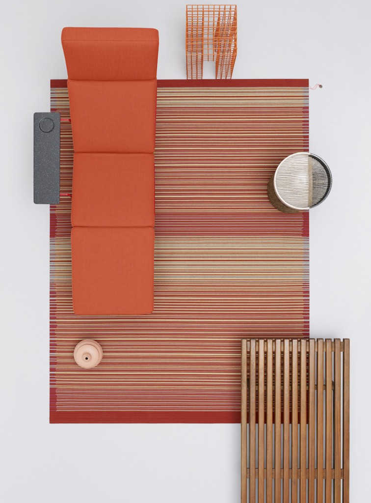 The 'Cork & Felt' rug by Hella Jongerius for Danskina as shot by Scheltens Abbenes with a bright orange 'Traffic' chaise by Konstantin Grcic for Magis.