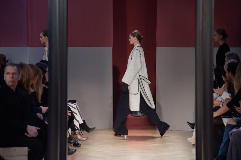 Graphic building blocks in pale grey and blood red set off the largely monochromatic clothing beautifully.