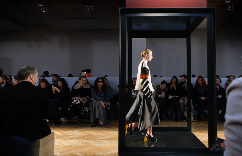 A side view of the Sportmax Autumn / Winter 2016 show as a model steps onto the floor of one of the towers - capturing her in a momentary frame.